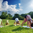 Group of people doing yoga — Stock Photo
