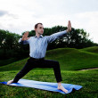 Businessman is doing yoga — Stok fotoğraf