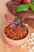 Baked white kidney beans with tomatoes and basil in a pot on wooden table — Stock Photo