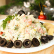 Russian vegetable salad with mushrooms on New Year Eve — Stock Photo