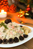 Traditional Russian salad on New Year night - vegetarian version with mushrooms — Stock Photo