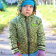Serious little boy outdoors  — Stockfoto