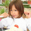 Little girl eating vegetable salad outdoors in summer — 图库照片 #36784971