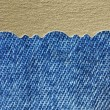 Blue jeans fabric texture with golden paper — Stock Photo