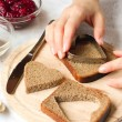 Cutting hearts from bread with cookie cutter — Stock Photo