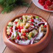Oriental pomegranate seeds salad with potatoes, dill and walnuts on wooden table — Stock Photo #37152681