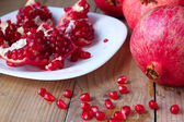 Fresh red pomegranates with seeds — Stock Photo