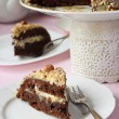 Stock Photo: Chocolate cake with buttercream and nuts