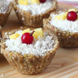 Healthy sweets. Vegan raw cupcakes with nuts, fruits and coconut shavings — Stock Photo #40873773