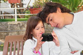Girl with her dad looking to the camera outdoors — Foto Stock