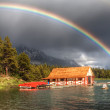 House on lake in nature with splendid rainbow — Stock Photo #27249599