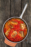 Fish in sauce — Stock Photo