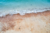 Wave of the sea on the sand beach — Stock Photo