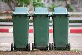 Row of green recycling bins in urban street — Stock Photo