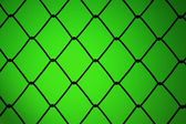Metallic net with green background — Stock Photo