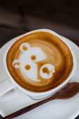 Cup of latte coffee like face bear — Stock Photo