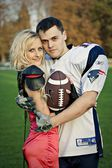 Rugby player and cheerleader — Stock fotografie