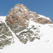 Mountain top with its slope covered in snow — ストック写真