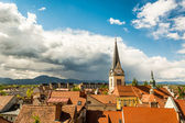 Panoramic view of residential district with a church tower — Stock Photo