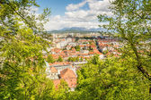 Panoramic view of a city with mountains in the back — Stock Photo