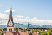 Panoramic view of residential district with a church tower — Stockfoto