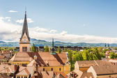 Panoramic view of old city district with a church — Foto Stock