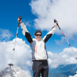Young woman celebrating on top of a mountain — Stock Photo #49386117