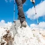 Young woman ascending a mountain ridge — Stock Photo #49388983