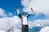 Young woman celebrating on top of a mountain — Stock Photo