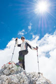 Young woman ascending a mountain — Stock Photo