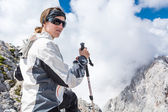 Female posing in front of a cloudy peaks — Stock Photo