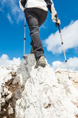 Young woman ascending a mountain ridge — Stock Photo