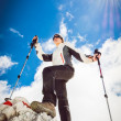 Young woman ascending a mountain — Stock Photo #49598703