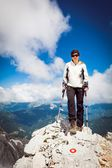 Female standing on top a mountain — Foto Stock