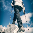Young woman ascending a mountain ridge — Stock Photo #49602659