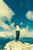 Female climber celebrating a successful ascend — Stock Photo