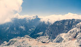 Panorama of a mountain valley partly covered with clouds — Stock Photo