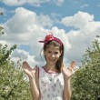 Girl in the sour cherry orchard happy — Stockfoto