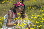 Girl in the sour cherry orchard smelling close — Stock Photo