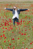Girl with poppies enjoy vertical — Stock fotografie