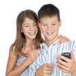 Girl & boy looking mobile phone — Foto Stock