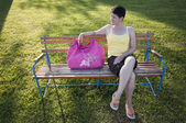 Woman sitting on bench — Stock Photo