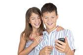 Girl & boy looking mobile phone — Stock Photo