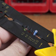 Stok fotoğraf: Wire stripper positioning