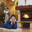 Two young men front of fireplace at Christmas — Stock Photo