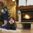 Two kid front of fireplace at Christmas — Stock Photo