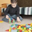 Boy playing with blocks — Stock Photo