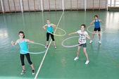 Teens in gymnasium — Stock Photo