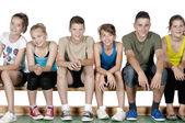 Athlete teens sitting — Stock Photo