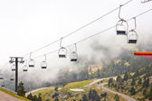 Chairlifts with fog — Stock Photo